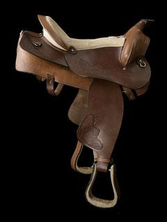 western saddle with stirrup irons